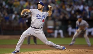 Los Angeles Dodgers starting pitcher Rich Hill delivers against the Oakland Athletics during the second inning of a baseball game Tuesday, Aug. 7, 2018, in Oakland, Calif. (AP Photo/D. Ross Cameron)