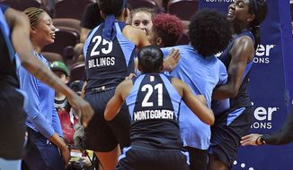 FILE - In this July 17, 2018, file photo, Atlanta Dream players mob Tiffany Hayes after her buzzer-beating 3-pointer against the Connecticut Sun at the end of a WNBA basketball game in Uncasville, Conn. With that dismal 2017 season firmly in the rear-view mirror, Atlanta is heading back to the playoffs as one of the league's hottest teams, carrying high hopes of finally winning its first WNBA championship. (Sean D. Elliot/The Day via AP, File)