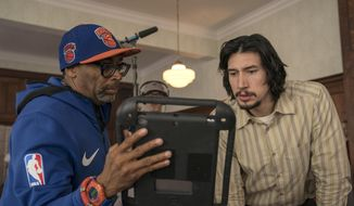 "This image released by Focus Features shows director Spike Lee, left, with actor Adam Driver on the set of Lee's film ""BlacKkKlansman."" (David Lee/Focus Features via AP)"