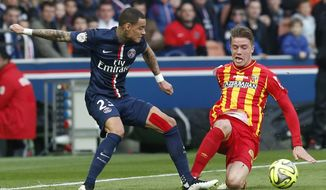 FILE - In this March 7, 2015 file photo, Paris Saint Germain's Gregory van der Wiel, left, and Lens' Baptiste Guillaume, right, battle for the ball during a League One soccer match Paris Saint Germain against Lens at Parc des Prince stadium in Paris. Guillaume has joined the Nimes team, a promoted team in the French League. (AP Photo/Michel Euler, File)