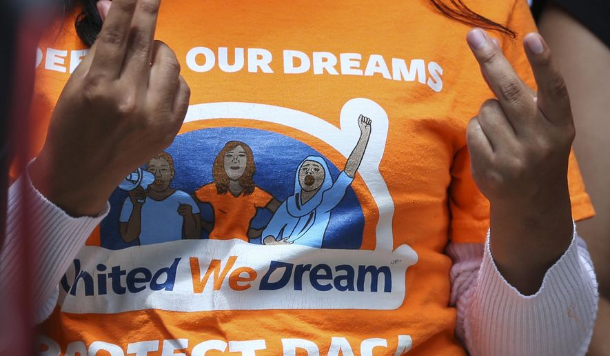 United We Dream youths and allies snap their fingers to show support to other DACA recipients speaking to the media after a court hearing in lawsuit filed by states challenging DACA program at the United States District Courthouse on Wednesday, Aug. 8, 2018, in Houston. (Yi-Chin Lee/Houston Chronicle via AP)