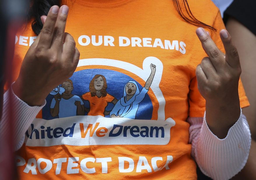 United We Dream youths and allies snap their fingers to show support to other DACA recipients speaking to the media after a court hearing in lawsuit filed by states challenging DACA program at the United States District Courthouse on Wednesday, Aug. 8, 2018, in Houston. (Yi-Chin Lee/Houston Chronicle via AP) ** FILE **