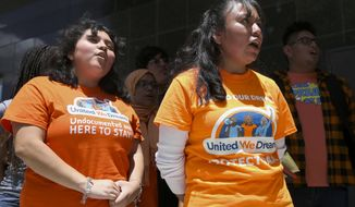 "Deferred Action for Childhood Arrivals (DACA) recipients Indira Nicole Marquez Robles, 18, left, Damaris Gonzalez, 34, and United We Dream youths and allies chant ""Here to Stay"" to the media after a court hearing in lawsuit filed by states challenging DACA program at the United States District Courthouse on Wednesday, Aug. 8, 2018, in Houston. (Yi-Chin Lee/Houston Chronicle via AP)"