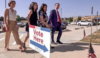 In a Friday, July 31, 2018 photo, Kansas Governor Jeff Colyer arrives with his family to advance vote at Hilltop Learning Center in Overland Park, Kansas. (John Sleezer/The Kansas City Star via AP)