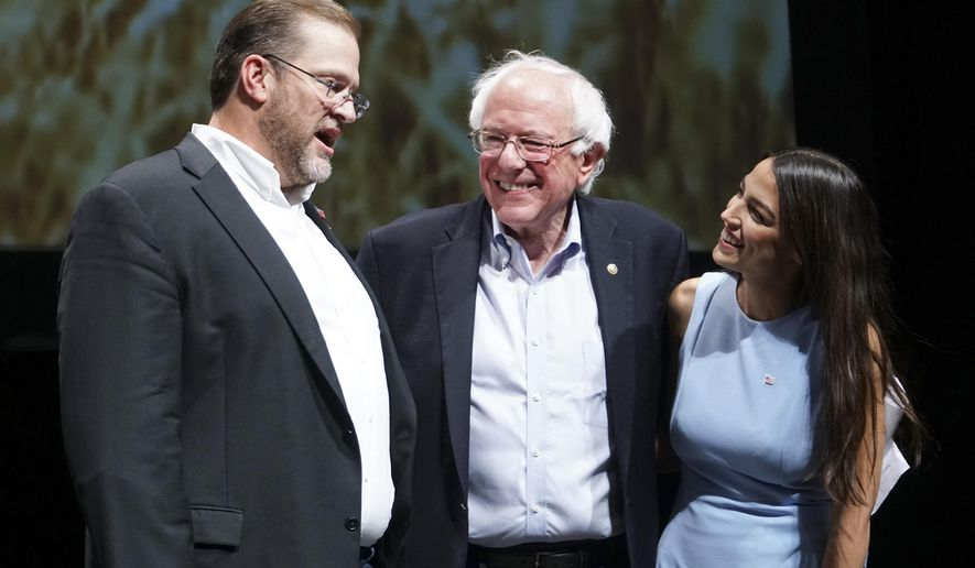In this July 20, 2018, file photo, Democratic Kansas U.S. congressional candidate James Thompson, left, U.S Sen. Bernie Sanders, I-Vt., and Alexandria Ocasio-Cortez, a Democratic congressional candidate from New York, stand together on stage after a rally in Wichita, Kan. (Jaime Green/The Wichita Eagle via AP, File) **FILE**