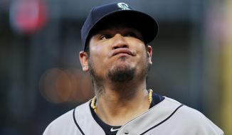 Seattle Mariners starting pitcher Felix Hernandez reacts after allowing a soft bunt-single by Texas Rangers' Carlos Tocci during the third inning of a baseball game Tuesday, Aug. 7, 2018, in Arlington, Texas. The Rangers won 11-4. (AP Photo/Brandon Wade)