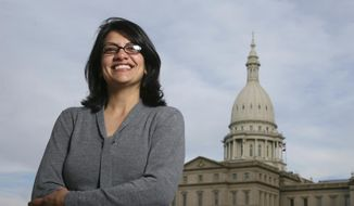 In this Thursday, Nov. 6, 2008, file photo, Rashida Tlaib, a Democrat, is photographed outside the Michigan Capitol in Lansing, Mich. In the primary election Tuesday, Aug. 7, 2018, Democrats pick former Michigan state Rep. Rashida Tlaib to run unopposed for the congressional seat that former Rep. John Conyers held for more than 50 years. Tlaib would be the first Muslim woman in Congress. (AP Photo/Al Goldis, File)