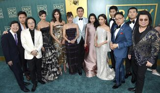 """The cast and crew of """"Crazy Rich Asians arrive at the film's premiere at the TCL Chinese Theatre on Tuesday, Aug. 7, 2018, in Los Angeles. (Photo by Richard Shotwell/Invision/AP)"""