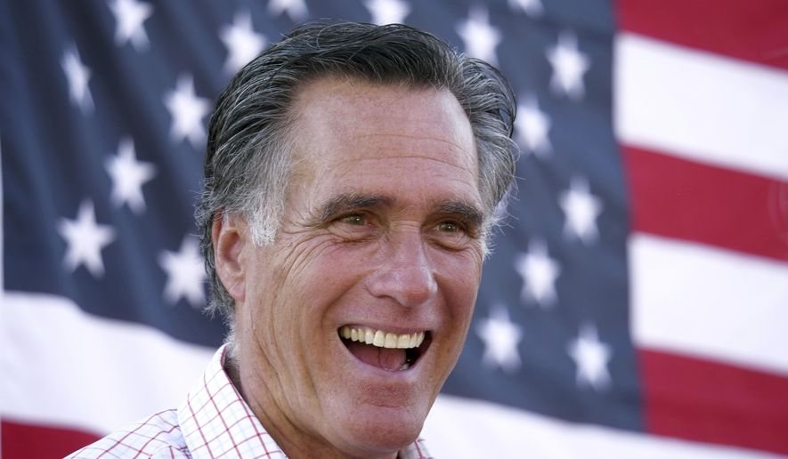 FILE - In this June 20, 2018, file photo, Mitt Romney smiles during a campaign event in American Fork, Utah. Romney is calling for a high-tech early detection system and more logging to prevent wildfires ravaging the U.S. West. The U.S. Senate candidate in Utah said in an essay Tuesday, Aug. 7, 2018, the government can do more to prevent fires there and other places like California, which is fighting its largest wildfire in state history. (AP Photo/Rick Bowmer, File)