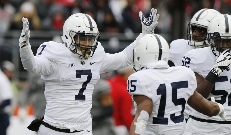FILE - In this Oct. 28, 2017, file photo, Penn State linebacker Koa Farmer (7) celebrates recovering a fumble against Ohio State during the first half of an NCAA college football game in Columbus, Ohio. Farmer has always been a big fan of TV crime dramas. After he is done playing football, Farmer wants in on the action, for real. The senior is a criminology and sociology major at Penn State. (AP Photo/Jay LaPrete, File)