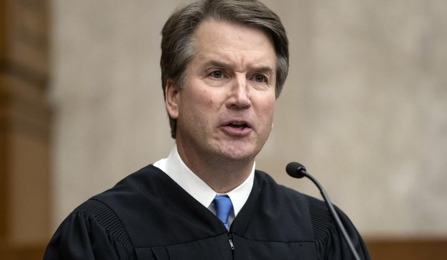 In this Aug. 7, 2018, file photo, President Donald Trump's Supreme Court nominee, Judge Brett Kavanaugh, officiates at the swearing-in of Judge Britt Grant to take a seat on the U.S. Court of Appeals for the 11th Circuit at the U.S. District Courthouse in Washington. (AP Photo/J. Scott Applewhite) ** FILE **