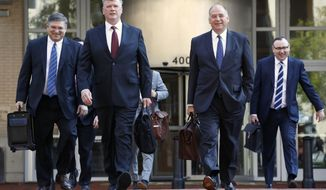 The defense team for Paul Manafort, including Kevin Downing, front left, and Thomas Zehnle, front right, arrive at federal court for the continuation of the trial of the former Trump campaign chairman, in Alexandria, Va., Wednesday, Aug. 8, 2018. (AP Photo/Jacquelyn Martin)