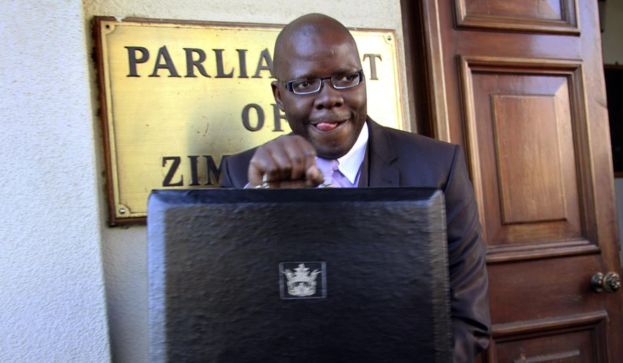 In this July, 18, 2012, file photo Tendai Biti, stands outside the Parliament Building in Harare, Zimbabwe. A Zimbabwean lawyer says that senior opposition official Tendai Biti has been arrested. Nqobizitha Mlilo, the lawyer, said Biti was arrested Wednesday, Aug. 8, 2018, while trying to cross into Zambia. (AP Photo/Tsvangirayi Mukwazh, File)