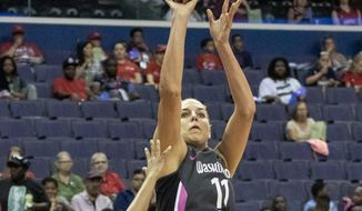 Washington Mystics forward Elena Delle Donne shoots against the Seattle Storm in a 100-77 win over the Seattle Storm on Thursday at Capital One Arena. (Arturo Holmes/Special to The Washington Times).