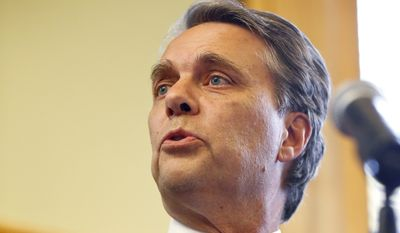CORRECTS SPELLING OF LAST NAME TO COLYER INSTEAD OF COYLER - Kansas Gov. Jeff Colyer addresses the media at the Kansas Statehouse in Topeka, Kan., Wednesday, Aug. 8, 2018, a day after his primary race against Kansas Secretary of State Kris Kobach. (Chris Neal/The Topeka Capital-Journal via AP)