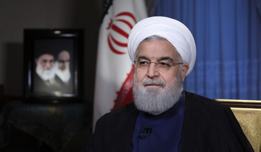 In this photo released by official website of the office of the Iranian Presidency, President Hassan Rouhani addresses the nation in a televised speech in Tehran, Iran, Monday, Aug. 6, 2018. (Iranian Presidency Office via AP) ** FILE **