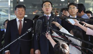 In this June 1, 2018, file photo, South Korean Unification Minister Cho Myoung-gyon, center, speaks to the media before leaving for the border village of Panmunjom to attend South and North Korean meeting, at the Office of the South Korea-North Korea Dialogue in Seoul, South Korea. Seoul said the rival Koreas agreed on high-level talks next Monday, Aug. 13, 2018, to prepare for a leaders' summit. The announcement Thursday, Aug. 9, 2018, by an official at the South's Unification Ministry comes amid attempts by Washington and Pyongyang to follow through on nuclear disarmament vows made at a summit in June between President Donald Trump and leader Kim Jong Un. (AP Photo/Ahn Young-joon, File)