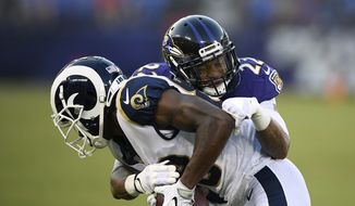 Baltimore Ravens defensive back Jimmy Smith (22) tackles Los Angeles Rams wide receiver Mike Thomas in the first half of a preseason NFL football game, Thursday, Aug. 9, 2018, in Baltimore. (AP Photo/Nick Wass) **FILE**