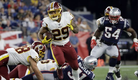 Washington Redskins running back Derrius Guice gains yardage against the New England Patriots during the first half of a preseason NFL football game, Thursday, Aug. 9, 2018, in Foxborough, Mass. (AP Photo/Steven Senne)