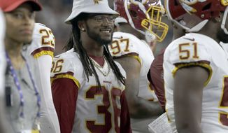 Washington Redskins defensive back D.J. Swearinger (36) watches from the sideline during the first half of a preseason NFL football game against the New England Patriots, Thursday, Aug. 9, 2018, in Foxborough, Mass. (AP Photo/Steven Senne)