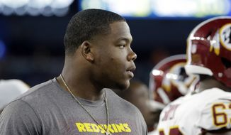 Washington Redskins defensive tackle Da'Ron Payne watches from the sideline during the first half of a preseason NFL football game against the New England Patriots, Thursday, Aug. 9, 2018, in Foxborough, Mass. (AP Photo/Steven Senne) **FILE**