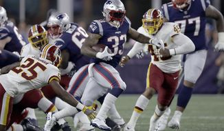 New England Patriots running back Jeremy Hill (33) gains yardage against the Washington Redskins during the first half of a preseason NFL football game, Thursday, Aug. 9, 2018, in Foxborough, Mass. (AP Photo/Charles Krupa)