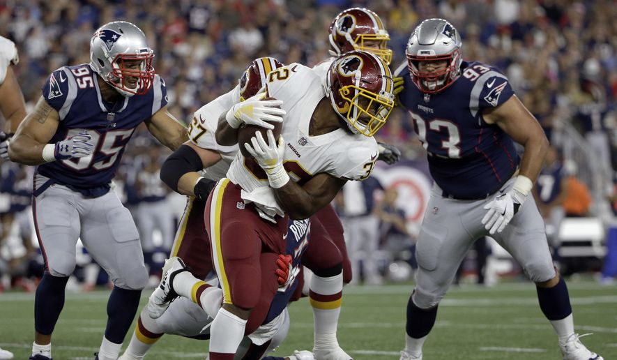 Washington Redskins running back Samaje Perine, center, gains yardage against the New England Patriots during the first half of a preseason NFL football game, Thursday, Aug. 9, 2018, in Foxborough, Mass. (AP Photo/Steven Senne) **FILE**