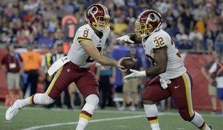 Washington Redskins quarterback Kevin Hogan (8) hands off to running back Samaje Perine (32) during the second half of a preseason NFL football game against the New England Patriots, Thursday, Aug. 9, 2018, in Foxborough, Mass. (AP Photo/Steven Senne) ** FILE **