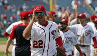 Washington Nationals' Juan Soto (22) celebrates with his teammates after a baseball game against the Atlanta Braves at Nationals Park, Thursday, Aug. 9, 2018, in Washington. The Nationals won 6-3. (AP Photo/Alex Brandon)