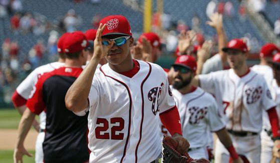 Washington Nationals' Juan Soto (22) celebrates with his teammates after a baseball game against the Atlanta Braves at Nationals Park, Thursday, Aug. 9, 2018, in Washington. The Nationals won 6-3. (AP Photo/Alex Brandon)