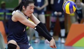 FILE - In this Aug. 18, 2016, file photo China's Zhu Ting controls the ball during a women's semifinal volleyball match against the Netherlands at the 2016 Summer Olympics in Rio de Janeiro, Brazil. A towering volleyball player who makes her living in Turkey is the unrivalled star of China's squad at the Asian Games in Indonesia. (AP Photo/Jeff Roberson, File)