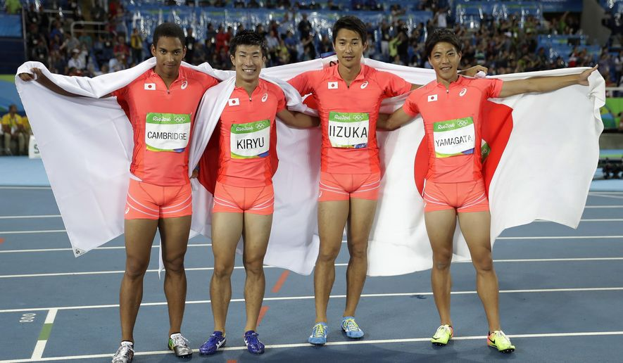 FILE - In this Aug. 19, 2016, file photo, Japan's Ryota Yamagata, Shota Iizuka, Yoshihide Kiryu and Aska Cambridge celebrate winning the silver medal in the men's 4 x 100-meter relay during the athletics competitions of the 2016 Summer Olympics at the Olympic stadium in Rio de Janeiro, Brazil. With the Tokyo Olympics less than two years away, Japanese athletes will be using the Asian Games to build confidence as they prepare to host the world on sport's biggest stage. (AP Photo/Matt Slocum, File)