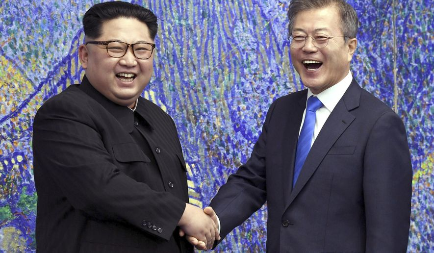 FILE - In this April 27, 2018, file photo, North Korean leader Kim Jong Un, left, poses with South Korean President Moon Jae-in for a photo inside the Peace House at the border village of Panmunjom in Demilitarized Zone, South Korea. The war-separated rivals will take their reconciliation steps to the Asian Games in Jakarta and Palembang, Indonesia, where they will jointly march in the opening ceremony and field combined teams in basketball, rowing and canoeing. (Korea Summit Press Pool via AP. Pool, File)