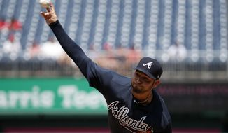 Atlanta Braves starting pitcher Anibal Sanchez throws during the first inning of a baseball game against the Washington Nationals at Nationals Park, Thursday, Aug. 9, 2018, in Washington. (AP Photo/Alex Brandon)