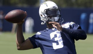 FILE - In this June 12, 2018, file photo, Los Angeles Chargers' Geno Smith throws a pass during the NFL football team's minicamp in Costa Mesa, Calif. The Chargers must choose between potential and experience when they select the next primary backup to Philip Rivers. Cardale Jones has displayed in one NFL game the tantalizing physical tools he showed in leading Ohio State to the 2014 national title. Geno Smith made 30 starts in his first two seasons, but has attempted 92 passes since 2014. (AP Photo/Chris Carlson, File)
