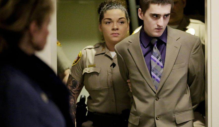 FILE - In this April 18, 2018 file photo, Michael Bever arrives at the Tulsa County Courthouse for his murder trial in Tulsa, Okla. Bever, convicted in May of five counts of first-degree murder in the fatally stabbing his parents and three of his siblings in 2015, is scheduled to be sentenced Thursday, Aug. 9, 2018. (Mike Simons/Tulsa World via AP, File)