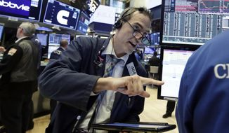 Trader Gregory Rowe works on the floor of the New York Stock Exchange, Thursday, Aug. 9, 2018. Stocks are off to a mixed start on Wall Street as gains for technology companies are offset by losses elsewhere in the market. (AP Photo/Richard Drew)