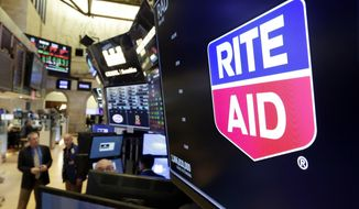 The logo for Rite Aid is displayed above a trading post on the floor of the New York Stock Exchange, Thursday, Aug. 9, 2018. Rite Aid and the grocer Albertsons called off an agreement to become a single company with the deal facing shaky prospects in a shareholder vote.(AP Photo/Richard Drew)