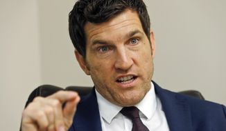 FILE - In this Friday, Oct. 7, 2016, file photo, Virginia's 2nd District Congressman Scott Taylor speaks during an interview in his campaign office in Virginia Beach, Va.  A special prosecutor in Virginia was appointed Tuesday, Aug. 7, 2018, to investigate potential election law violations in a tight congressional race that could help Democrats reclaim the U.S. House. Political observers said the probe could hurt Taylor in what's become an increasingly competitive district along Virginia's coast. But it will likely depend on the investigation's outcome. (AP Photo/Steve Helber, File)