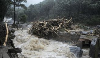 Water gushes out following heavy rain and landslide in Kozhikode, Kerala state, India, Thursday, Aug. 9, 2018. Landslides triggered by heavy monsoon rains have killed more than a dozen people in southern India, cutting off road links and submerging several villages. (AP Photo)