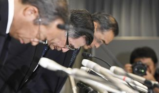 Suzuki Motor Corp. Representative Director and President Toshihiro Suzuki, second from left, bows with other official at the start of a press conference Thursday Aug. 9, 2018 in Tokyo. Suzuki Motor Corp., Mazda Motor Corp. and Yamaha Motor Co. have admitted using falsified emissions data to inspect their new vehicles in a product quality scandal in Japan's auto industry. (Akiko Matsushita/Kyodo News via AP)