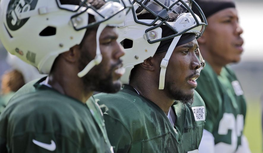 FILE - In this Monday, Aug. 6, 2018, file photo, New York Jets' Doug Middleton, center, looks at the field during practice at the NFL football team's training camp in Florham Park, N.J.  Middleton was impressing the Jets with his playmaking skills last summer when a torn pectoral muscle in a preseason game knocked him out for the season. Nearly a year later, Middleton has a master's degree in public administration from Appalachian State on his resume. (AP Photo/Seth Wenig, File)