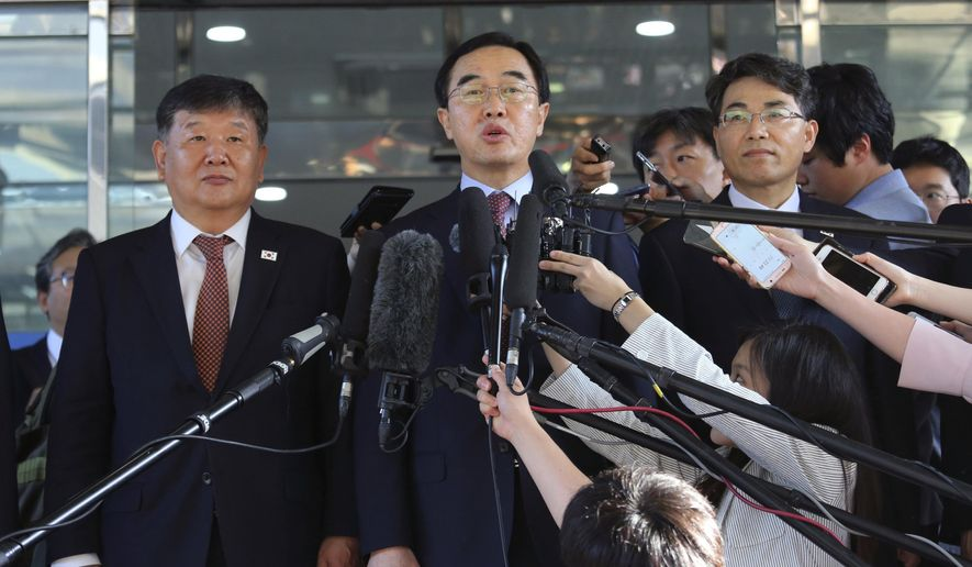 In this June 1, 2018, file photo, South Korean Unification Minister Cho Myoung-gyon, center, speaks to the media before leaving for the border village of Panmunjom to attend South and North Korean meeting, at the Office of the South Korea-North Korea Dialogue in Seoul, South Korea. (AP Photo/Ahn Young-joon, File)