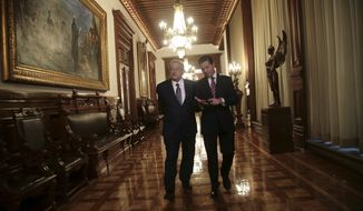 In this photo released by the press office of Mexico's President-elect Andres Manuel Lopez Obrador, Mexican President Enrique Pena Nieto, right, walks with Lopez Obrador inside the National Palace in Mexico City, Thursday, Aug. 9, 2018. Lopez Obrador will take office Dec. 1. (Press Office of Andres Manuel Lopez Obrador via AP)