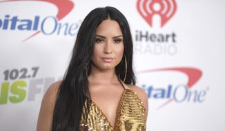 In this Dec. 1, 2017, file photo, Demi Lovato arrives at Jingle Ball at The Forum in Inglewood, Calif. (Photo by Richard Shotwell/Invision/AP, File)