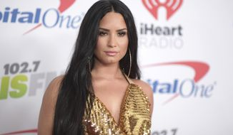 In this Dec. 1, 2017 file photo, Demi Lovato arrives at Jingle Ball at The Forum in Inglewood, Calif.  Lovato has canceled the rest of her fall tour to focus on her recovery. Over the weekend Lovato checked out of the hospital she was rushed to on July 24 for a reported overdose. (Photo by Richard Shotwell/Invision/AP, File)