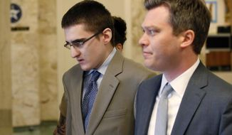 FILE - In this Tuesday, April 17, 2018 file photo, Michael Bever, left, is led from a courtroom following jury selection in his trial in Tulsa, Okla.. At right is his defense attorney Corbin Brewster. Michael Bever, the younger of two brothers accused of fatally stabbing their parents and three siblings inside a suburban Oklahoma home, has been sentenced to life in prison but with the possibility of parole, Thursday, Aug. 9. (AP Photo/Sue Ogrocki, File)