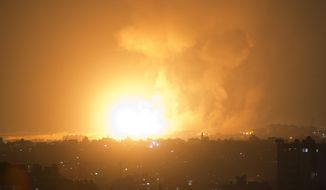 An explosion caused by Israeli airstrikes on Gaza City, early Thursday, Aug. 9, 2018. Israel struck targets in the Gaza Strip after dozens of rockets were launched Wednesday from the coastal territory ruled by the Islamic militant Hamas group, the Israeli military said. (AP Photo/Khalil Hamra)