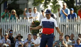 Gary Woodland reacts to a birdie on the 16th hole during the first round of the PGA Championship golf tournament at Bellerive Country Club, Thursday, Aug. 9, 2018, in St. Louis. (AP Photo/Charlie Riedel)