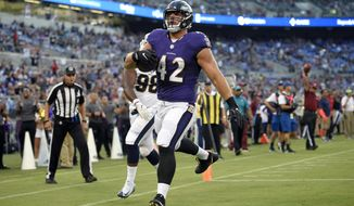 Baltimore Ravens fullback Patrick Ricard scores a touchdown in the first half of a preseason NFL football game against the Los Angeles Rams, Thursday, Aug. 9, 2018, in Baltimore. (AP Photo/Nick Wass)